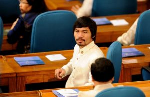 Congressman and world champion boxing hero Manny Pacquiao sits with fellow lawmakers at the House of Representatives on July 25, 2011.