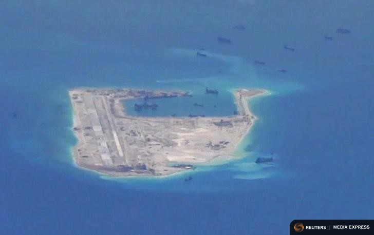 Chinese dredging vessels are purportedly seen in the waters around Fiery Cross Reef in the disputed Spratly Islands in this still image from video taken by a P-8A Poseidon surveillance aircraft provided by the United States Navy May 21, 2015. REUTERS/U.S. Navy/Handout via Reuters/Files