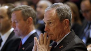 New York City Mayor Michael Bloomberg waits to speak at a gun violence summit at Johns Hopkins Bloomberg School of Public Health in Baltimore, Monday, Jan. 14, 2013, where he outlined his proposals for federal gun control reforms. Sitting alongside Bloomberg is Maryland Gov. Martin O'Malley. Bloomberg urged President Barack Obama and Congress to increase background check requirements for firearms purchases, and also said the federal government needs to get tougher on gun trafficking. (AP Photo/Patrick Semansky)